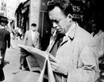 Camus lee el periódico, 1953